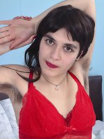 Lilly Scabette wears red as she strips nude in bed